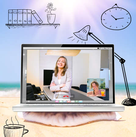 laptop computers: mobile office, making a video call with modern laptop on beach Stock Photo