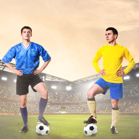 rival: two rival soccer or football players are standing on stadium Stock Photo