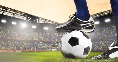 uniform green shoe: legs of soccer or football player at stadium Stock Photo