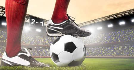 uniform green shoe: legs of soccer or football player at stadium Stock Photo