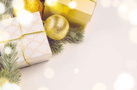 surface view: decorative christmas gift boxes and balls on white surface, view from above Stock Photo