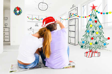 young couple is planning christmas or new year decoration of their new apartments photo