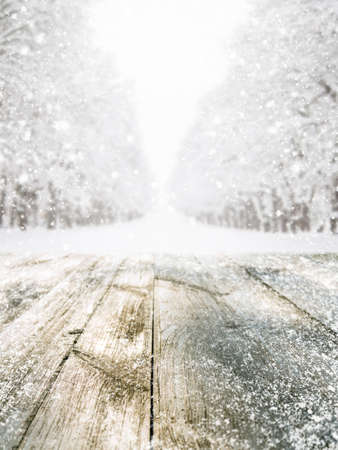 flare up: Empty wooden table at snowy winter forest Stock Photo