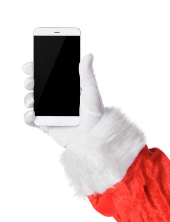 Santa holding smartphone with black blank screen in hand isolated on white. Screen is cut with clipping path