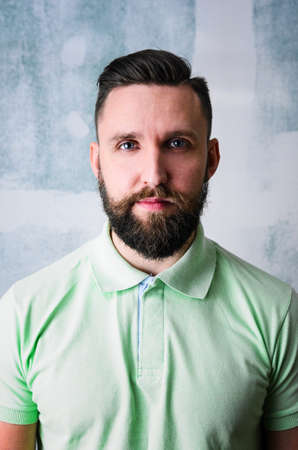 young adult man: Portrait of young adult bearded happy man looking at camera Stock Photo
