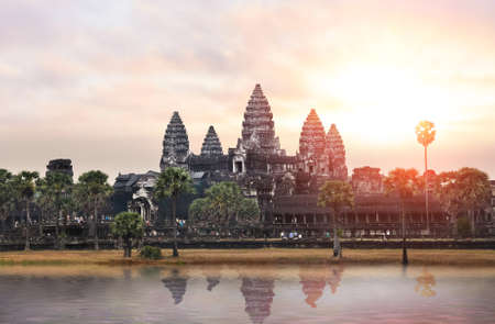 Sunrise at Angkor Wat, part of Khmer temple complex, popular among tourists ancient landmark and place of worship in Southeast Asia. Siem Reap, Cambodia. Stock Photo