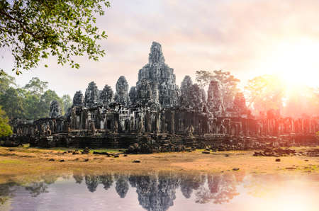 Prasat Bayon, part of Angkor Khmer temple complex, popular among tourists ancient landmark and place of worship in Southeast Asia. Siem Reap, Cambodia. Stock Photo