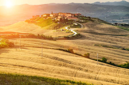 Sunset summer landscape of village in Tuscany, Italy