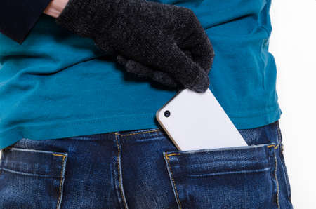 Taking modern smartphone out of pocket. Stock Photo