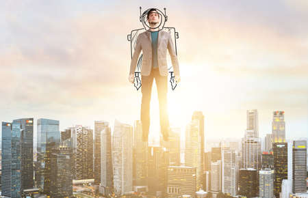 Business Advantage. Businessman in sketch astronaut costume hovering over down town on sunset. Stockfoto