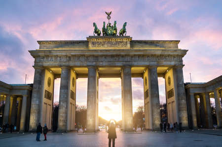 Illuminated Brandenburg Gate sunset view, Berlin, Germany Stock Photo