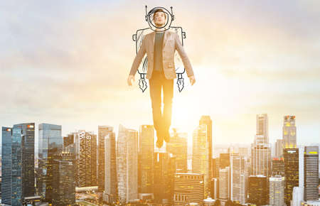 Business Advantage. Businessman in sketch astronaut costume hovering over down town on sunset. Stock fotó