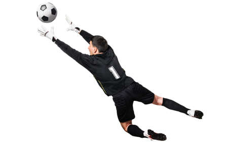 Soccer or football goalkeeper is catching a ball, isolated on white background