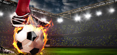 legs of soccer or football player at stadium Stock Photo