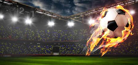 Voetbal of voetbal bal aan het vuur in het stadion