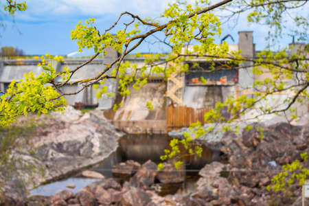 Hydroelectric power plant and dam in Imatra, Finland. Blurred, focus on branch