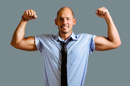 Strong businessman concept. Business man showing muscular hands Reklamní fotografie