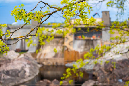 Hydroelectric power plant and dam in Imatra, Finland. Focus on tree branch Stock Photo