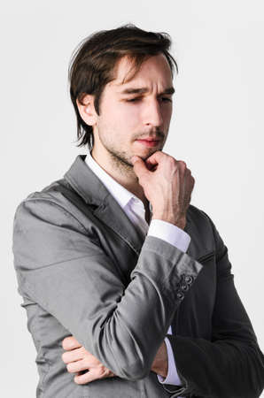 Businessman planning business strategy, against gray background