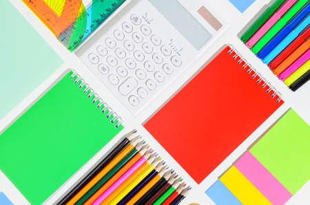 School accessories, books against white background