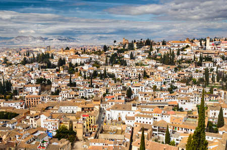 Panoramic view of Granada city against mountains, Andalusia, Spain