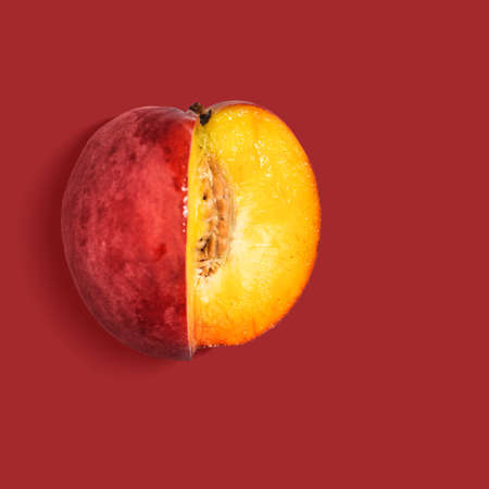 Fresh nectarine on red background, view from above Stock fotó