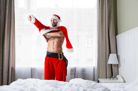 Santa Claus in hotel room without costume getting ready for Christmas or New Year Imagens - 88600263