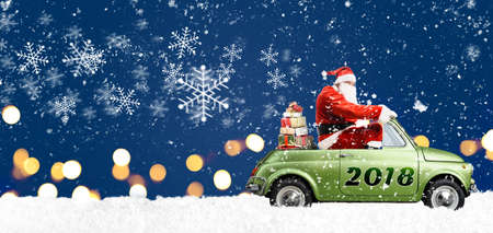 Santa Claus on car delivering Christmas or New Year gifts at snowy blue background