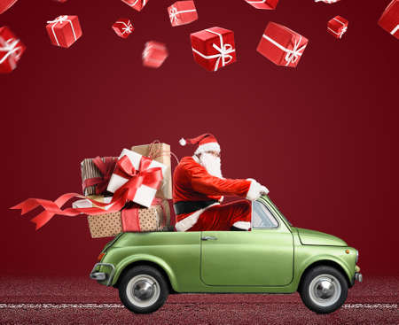 Santa Claus on car delivering Christmas or New Year gifts at red background