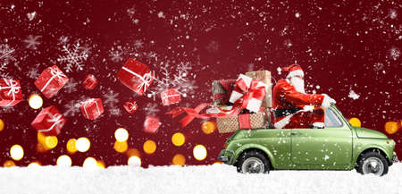 Santa Claus on car delivering Christmas or New Year gifts at snowy red background