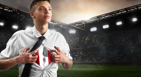 Peru soccer or football supporter showing flag under his business shirt on stadium. Stock Photo