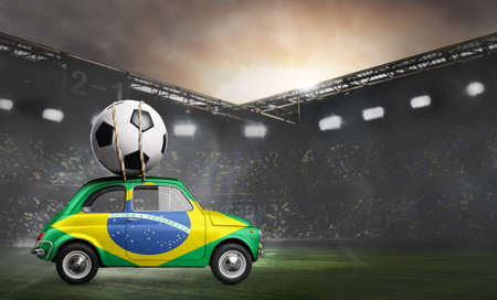 Brazil flag on car delivering soccer or football ball at stadium Stock Photo