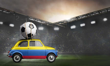 Colombia flag on car delivering soccer or football ball at stadium Stock Photo