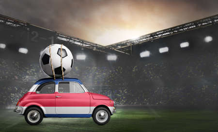 Costa Rica flag on car delivering soccer or football ball at stadium Stock Photo