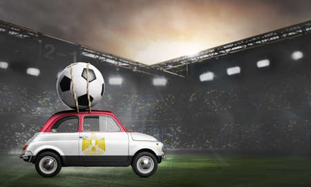 Egypt flag on car delivering soccer or football ball at stadium Stock Photo