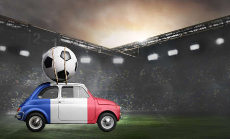 France flag on car delivering soccer or football ball at stadium