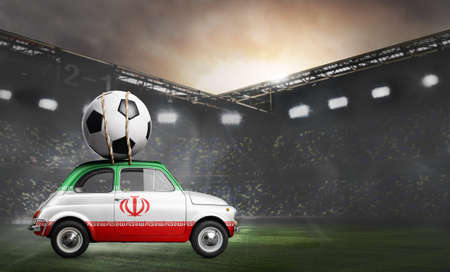 Iran flag on car delivering soccer or football ball at stadium