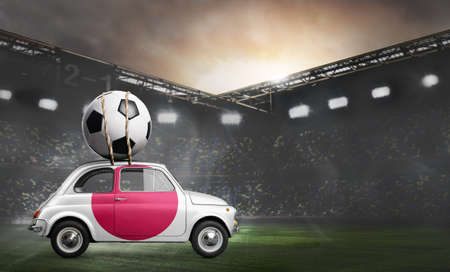 Japan flag on car delivering soccer or football ball at stadium Stock Photo