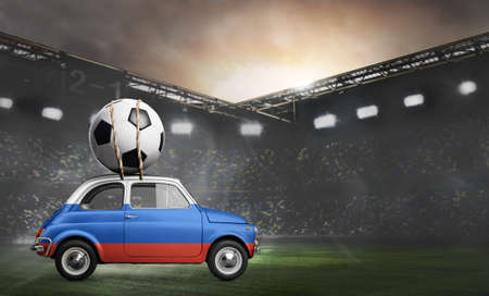 Russia flag on car delivering soccer or football ball at stadium Stock Photo