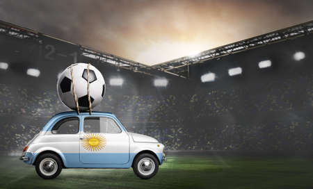 Argentina flag on car delivering soccer or football ball at stadium