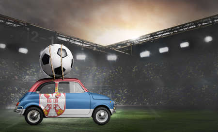 Serbia flag on car delivering soccer or football ball at stadium Stock Photo