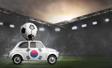 Korea flag on car delivering soccer or football ball at stadium Stock Photo