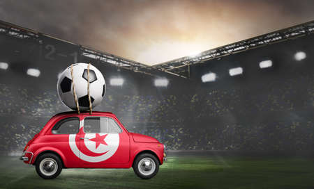 Tunisia flag on car delivering soccer or football ball at stadium
