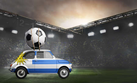 Uruguay flag on car delivering soccer or football ball at stadium Stock Photo