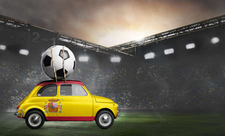 Spain flag on car delivering soccer or football ball at stadium Stock Photo