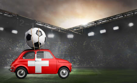 Switzerland flag on car delivering soccer or football ball at stadium