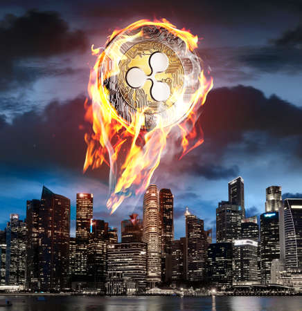 Ripple on fire. Flaming btc coin is going up to night sky above business skyscrapers
