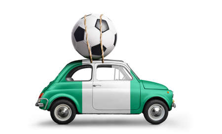 Nigeria flag on car delivering soccer or football ball isolated on white background Stock Photo