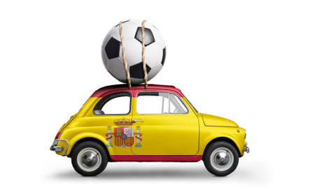 Spain flag on car delivering soccer or football ball isolated on white background Stock Photo