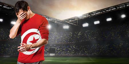 Tunisia national team. Sad soccer or football player on stadium Reklamní fotografie